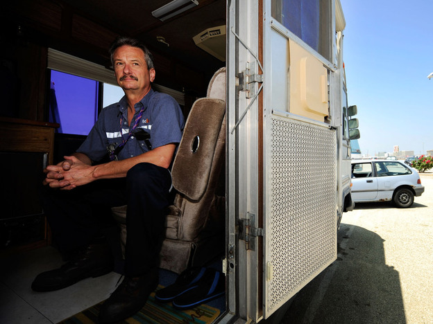 Aircraft mechanic Jere Herr of Indianapolis prepares to go to work while seated in his recreational vehicle, parked in a lot at the Los Angeles International Airport. He lives by the airport to save money for the future. One-third of Americans will have to rely on Social Security benefits — not pensions — in their retirement years.
