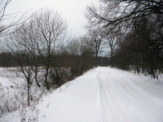 A snow-covered road leading to the proposed casino site is nearly impassable this time of year. Casino planners promise better roads, as well as an upgraded airport for the region.