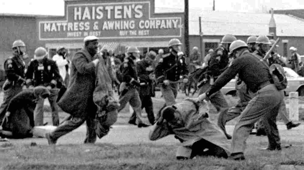 State troopers swing billy clubs to break up a civil rights march in Selma, Ala., on March 7, 1965.