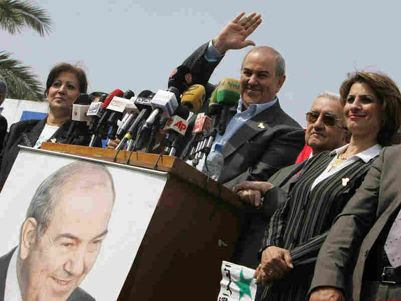 Former Iraqi Prime Minister Iyad Allawi waves to his supporters.