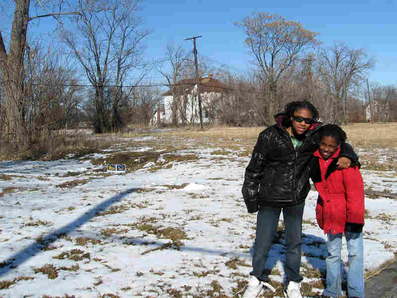 Celeste Moore (left), 11, and her sister Ricki Collins, 9, live in the only house left on the block