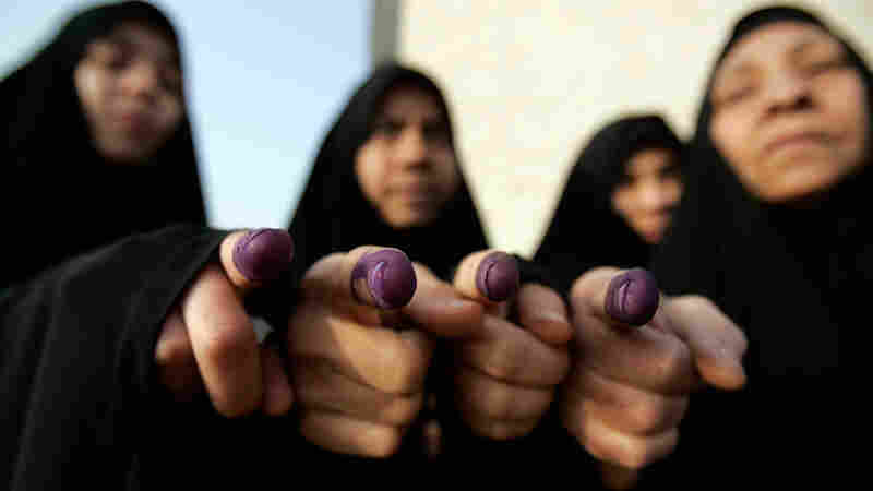 Iraqi women display their ink-stained fingers after voting in provincial elections in 2009.