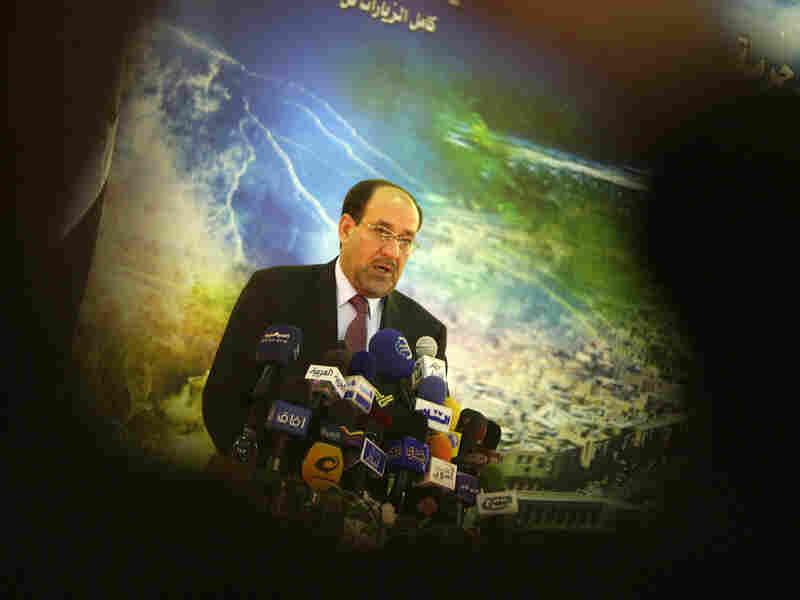 Iraqi Prime Minister Nouri al-Maliki delivers a speech to supporters.