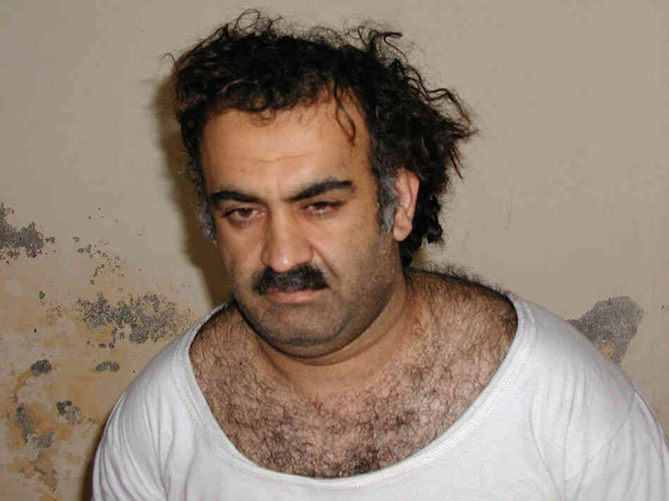 In this now iconic March 1, 2003 photo, Khalid Sheikh Mohammed is seen shortly after his capture.