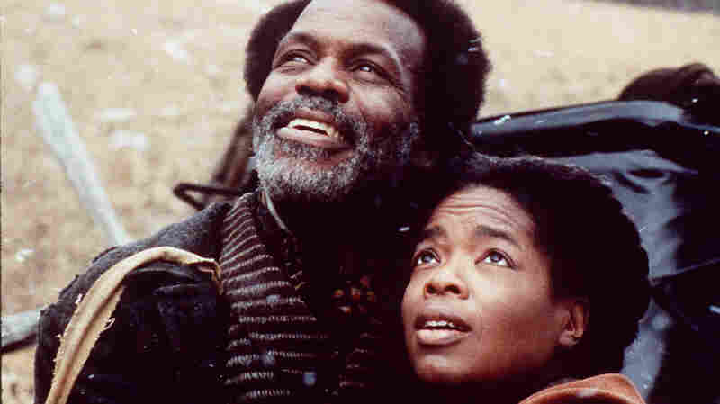 Oprah Winfrey (right) and Danny Glover star in the 1998 film Beloved.