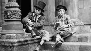Jack Wild, left, and Mark Lester played the Artful Dodger and Oliver Twist in Oliver!