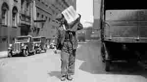 A workman delivers ice in 1936.