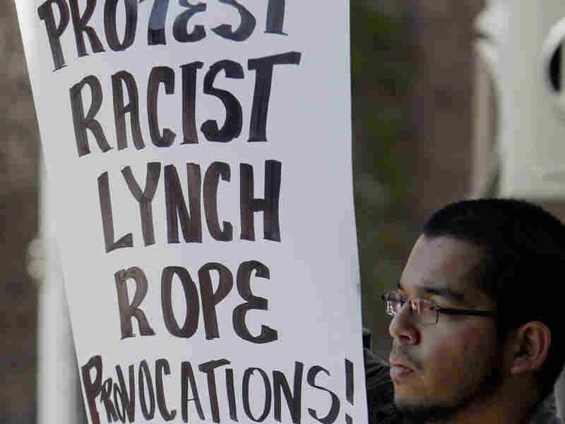 A man protests a recent racist party