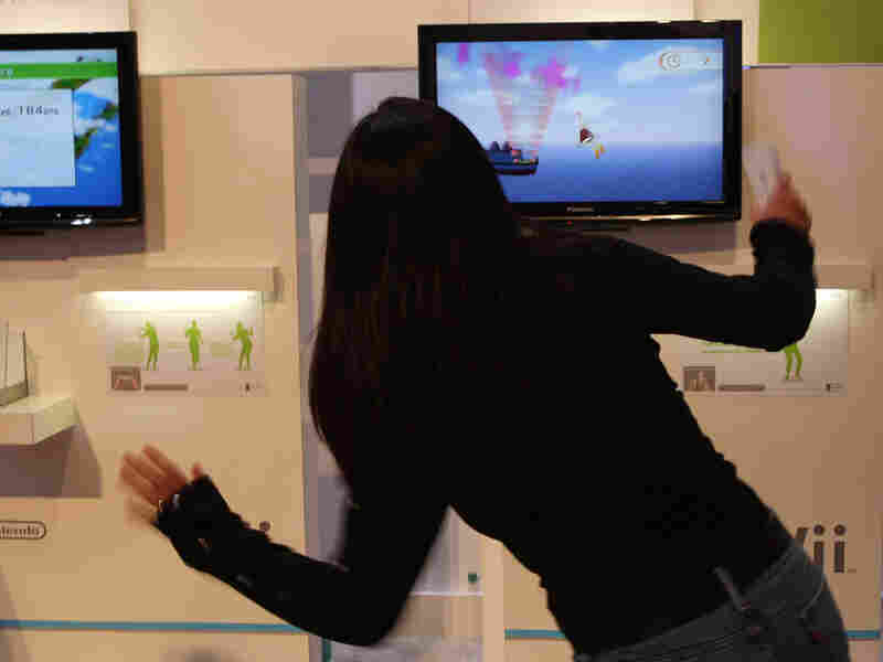 A woman plays a Wii Fit Plus game in 2009