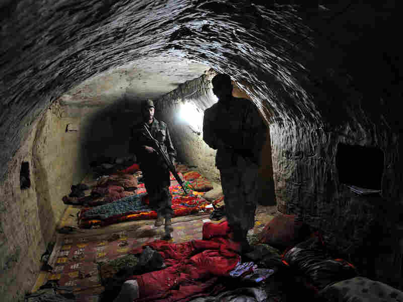 Pakistani soldiers in a captured Taliban complex near the Afghan border