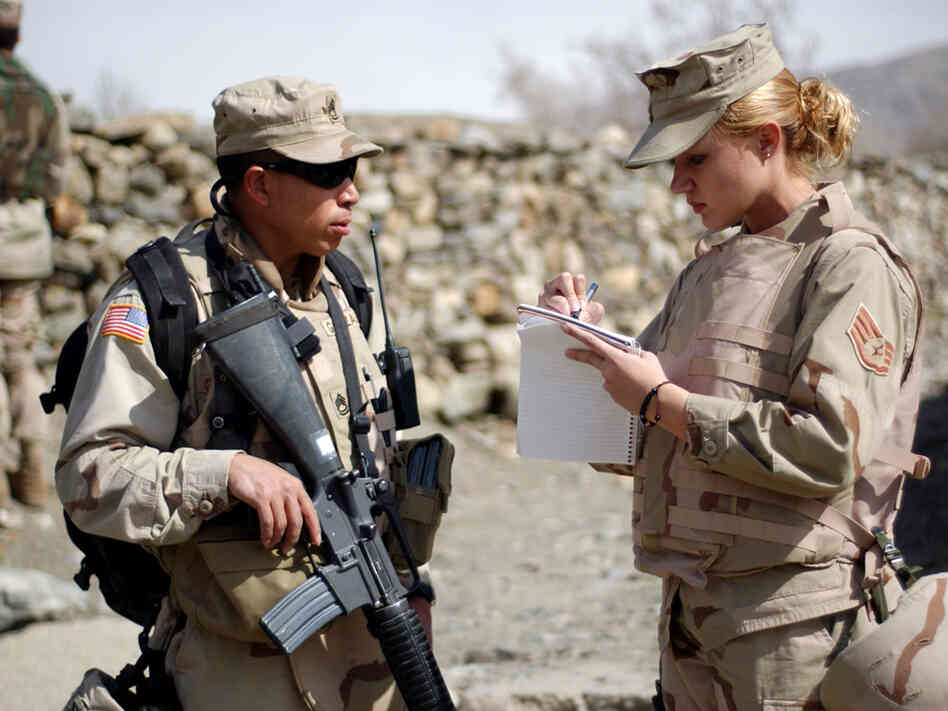 Staff Sgt. Marti Ribeiro interviews an Army sergeant while embedded with a unit in Afghanistan.