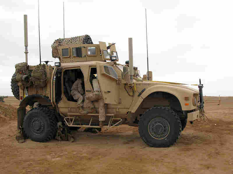 Marines load up their mine-resistant armored truck in Marjah, Afghanistan.