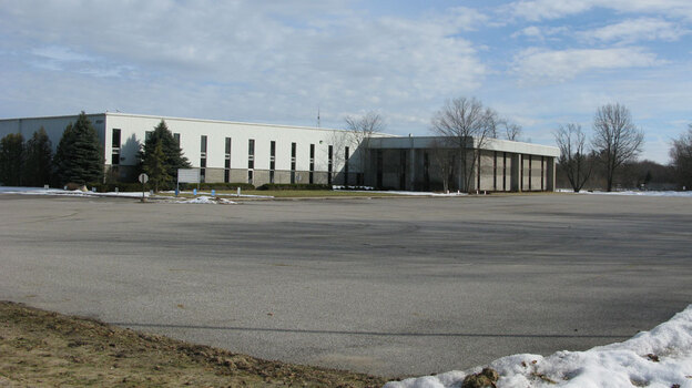 The exterior of the empty Phillips Industries plant in Elkhart, where city and state officials recently welcomed the electric car company Think, which plans to assemble electric cars in this plant and eventually hire more than 400 workers. (NPR)