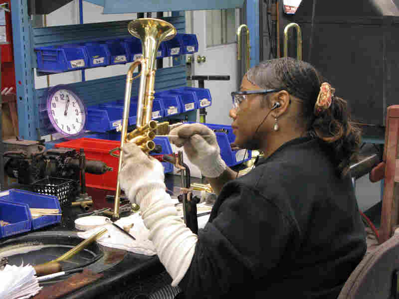 An employee cleans sections of a trumpet at Conn-Selmers' Vincent Bach division.