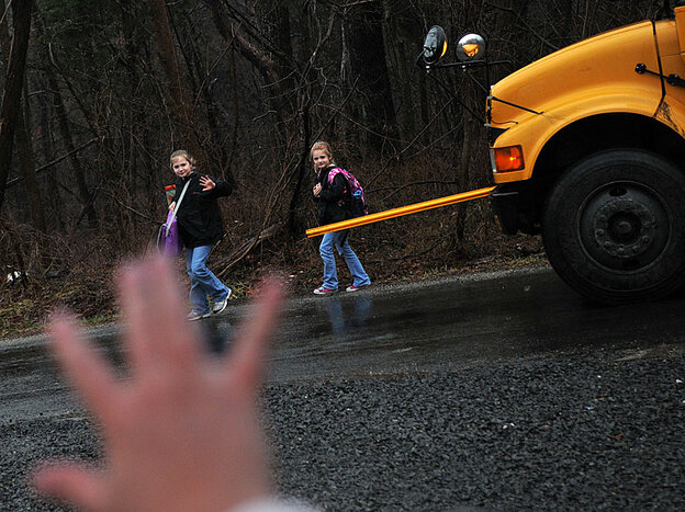Kristy Stumpf meets her daughters at the school bus stop