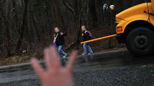 Kristy Stumpf, who works from her home in Broad Run, Va., part of the week, greets her daughters Lauren, 9 (left), and Lacey, 6 (right), as they hop off the school bus. Stumpf's employer, List Innovative Solutions, lets employees largely set their own hours.