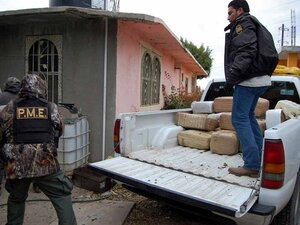 Police unload packages of confiscated marijuana in Nuevo Laredo, Tamaulipas state.