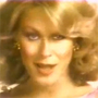 A screenshot from the classic Enjoli perfume ad of the 1970s
