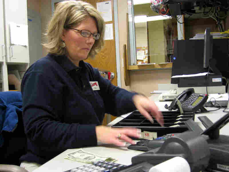 Tina Burgess in the front office of a grocery store in Michigan.