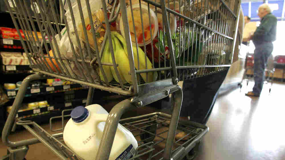 A grocery cart full of items.