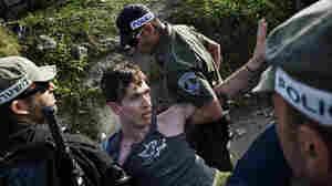 Israeli police detain a left-wing Israeli activist.