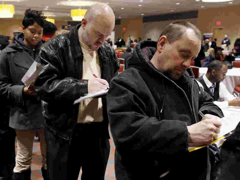Detroit job seekers attend an employment fair.