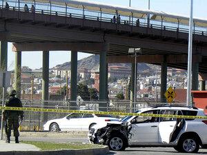 A Mexican soldier patrols the scene where three U.S. consulate staffers were slain in Ciudad Juarez.