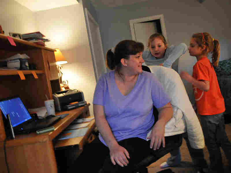 Stumpf spends time with her daughters while getting some work done in her home office