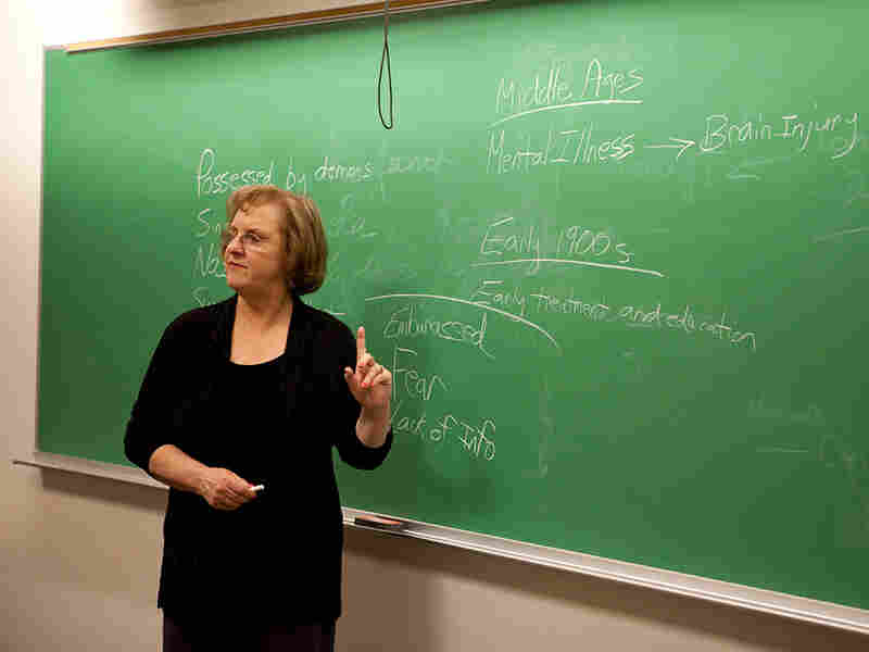 Janis Ruoff, a professor at The George Washington University, uses a blackboard.