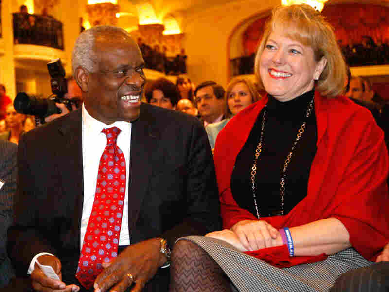 Supreme Court Justice Clarence Thomas sits with his wife, Virginia Lamp Thomas.