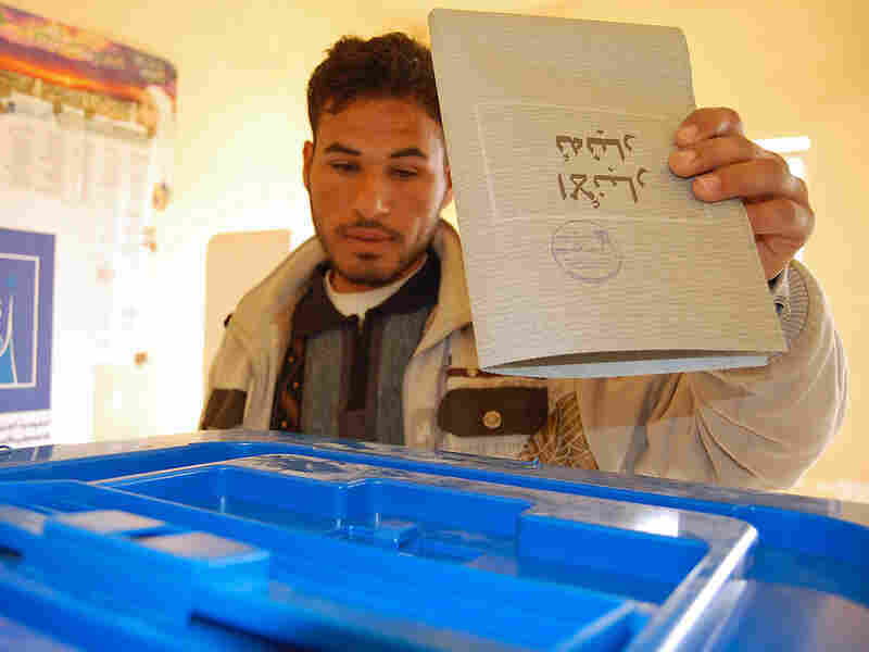 An Iraqi man casts his vote at a polling station in the Sunni bastion of Fallujah.