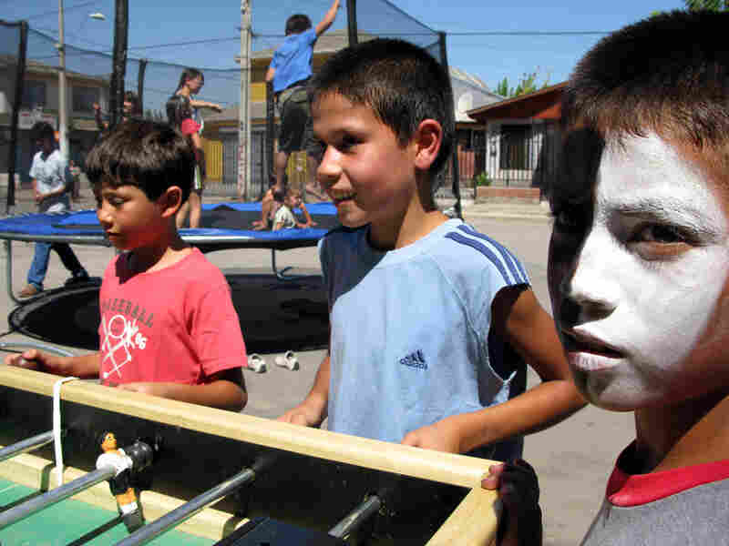 Children play at a street fair in Santiago, Chile.