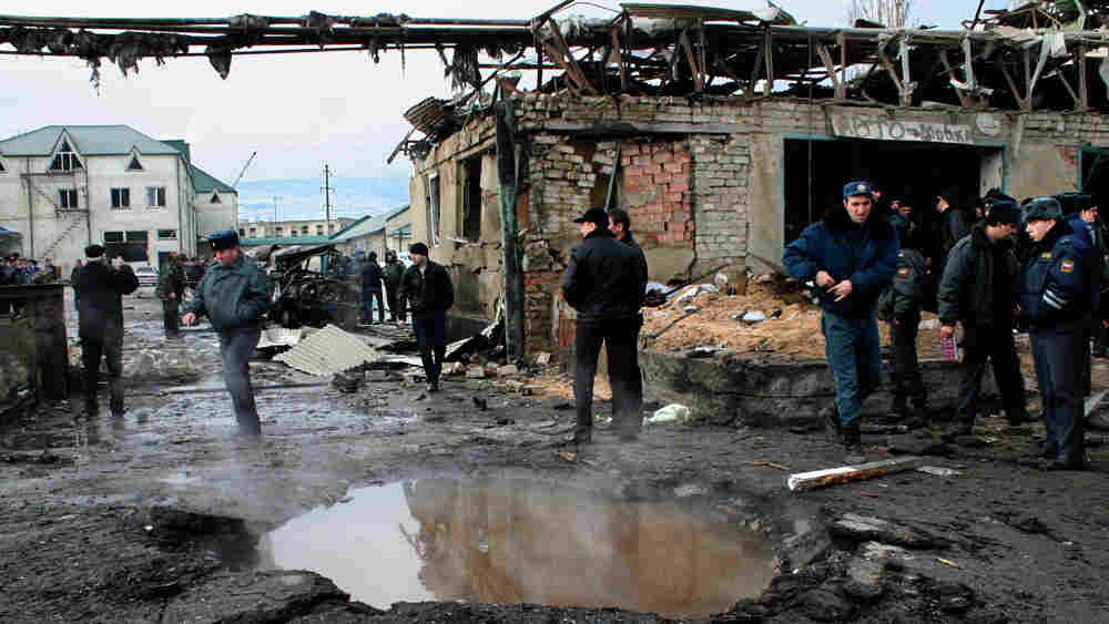 Police officers and investigators at the site of an explosion on the outskirts of Makhachkala.