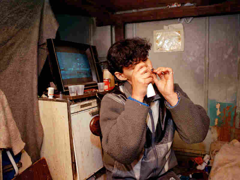 An unidentified woman smokes crack in New York, 1990.