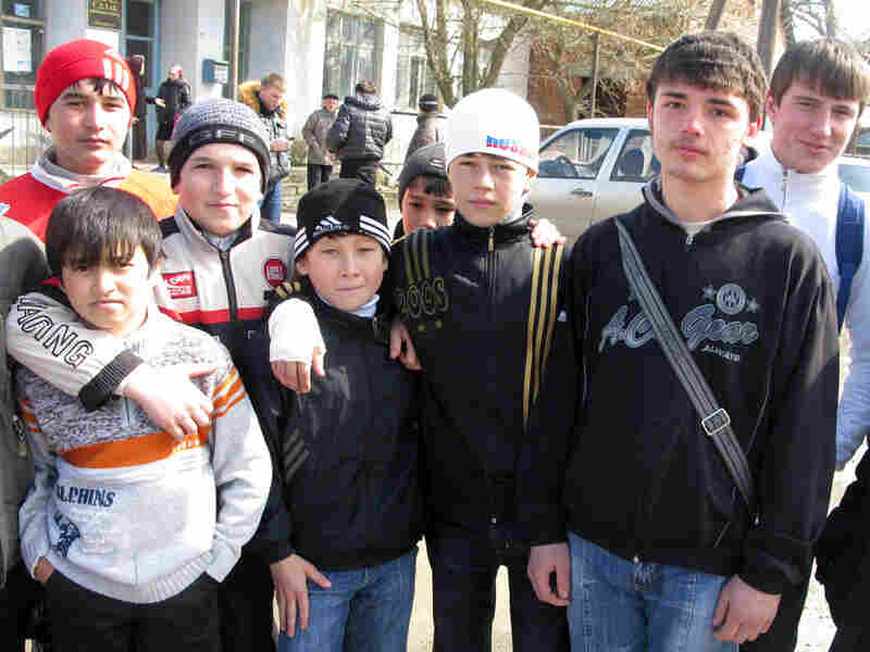 Fifteen-year-old Roman Klimenko in the streets of Sulak, Dagestan, Russia.