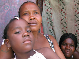 Marie Claudine Macena and her daughters, residents of Petionville Club camp
