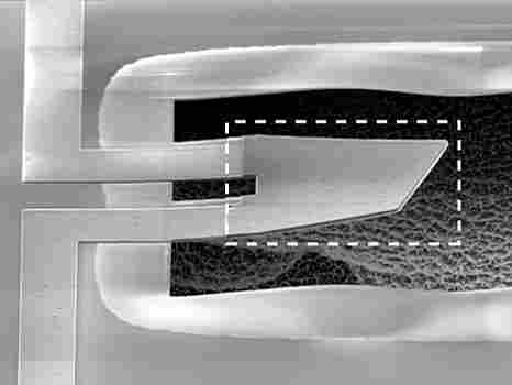 A magnified view of the tiny hair-thin device, called a resonator.