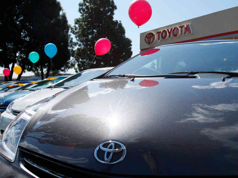 Toyota Priuses lined up at a dealership in California.