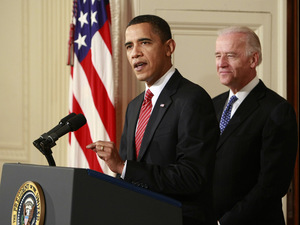President Barack Obama, joined by Vice President Joe Biden, makes a statement to the nation Sunday night following the final vote in the House of Representatives for a comprehensive overhaul of the health care system.