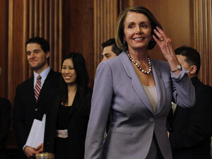 House Speaker Nancy Pelosi walks past House staff as she arrives to give a speech on health care.