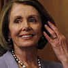 House Speaker Nancy Pelosi walks past House staff as she arrives to give a speech on health care.