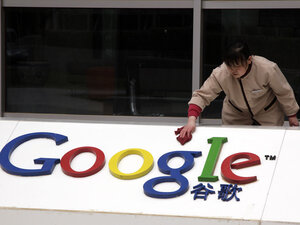 A Chinese worker cleans the Google logo at the Google China headquarters in Beijing on Monday.