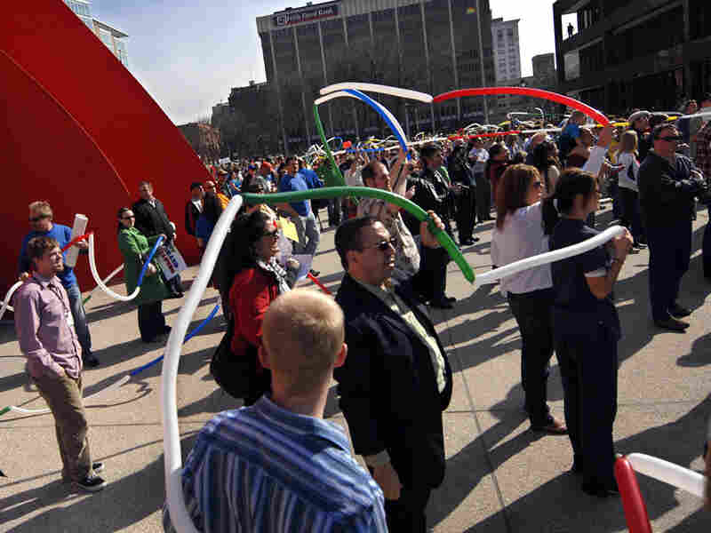 A crowd holds balloons symbolizing fiber-optic cable at a March 19 event in Grand Rapids, Mich.