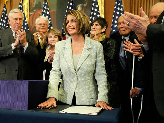 Democrats after signing the health care overhaul bill Monday.