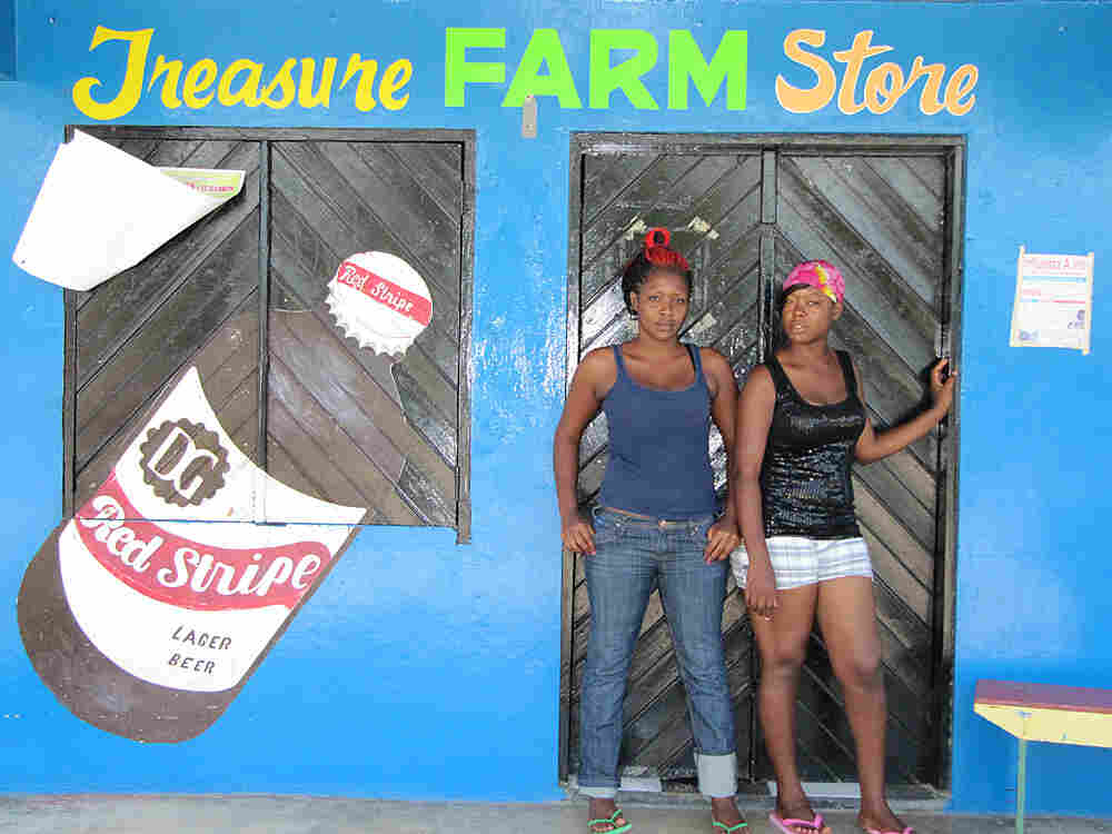 Kadesha Abrahms (left) at a feed store in Treasure Beach, Jamaica, says girls want to be slim.