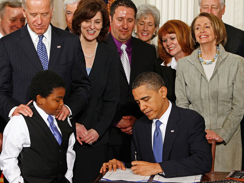 Image result for photos president obama signing ACA