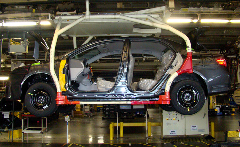 A Car Moves Down The Auto Embly Line At New United Motor Manufacturing Inc Joint Venture Between General Motors And Toyota That Produces