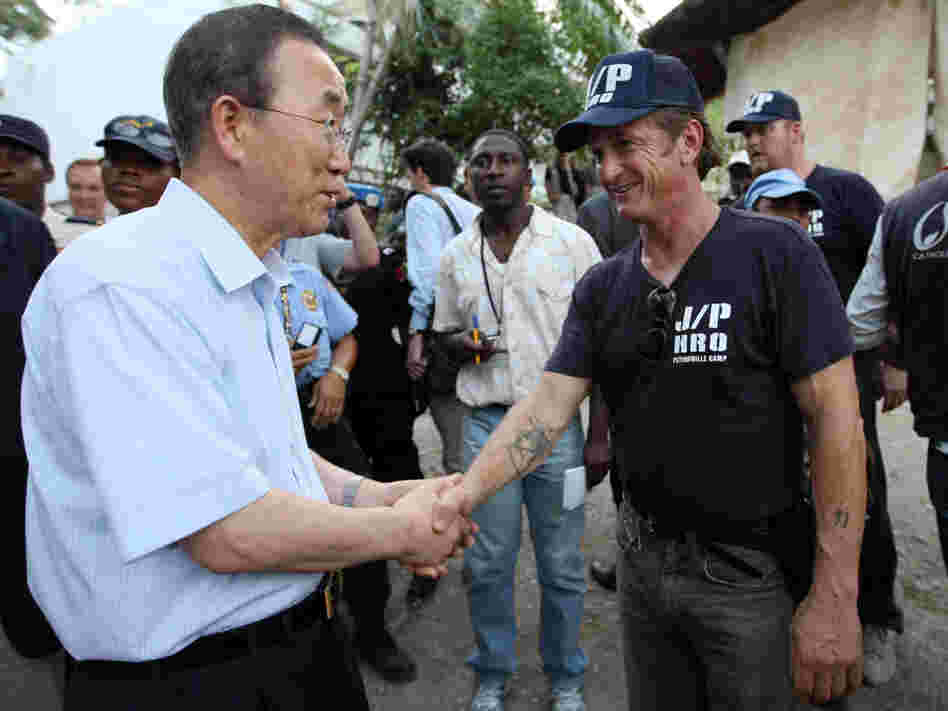 U.N. Secretary-General Ban Ki-moon greets actor Sean Penn in a Haitian tent camp.