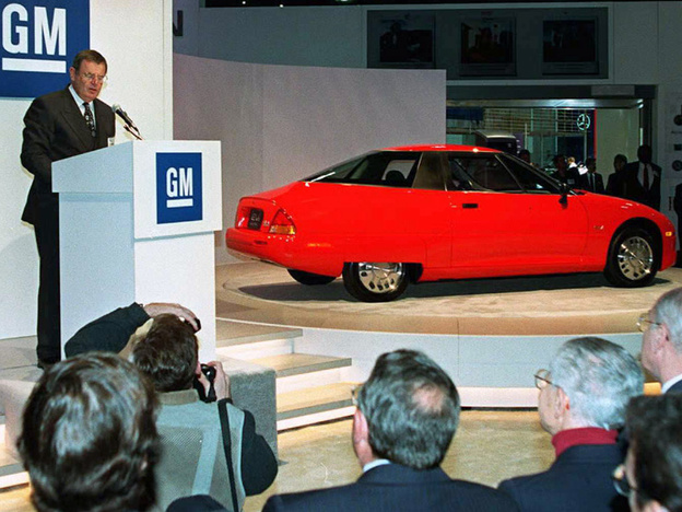 GM Chairman John F. Smith announces plans to produce the new EV1 electric car in January 1996. At the time, GM was the first major automaker to market specifically designed electric vehicles to the public.