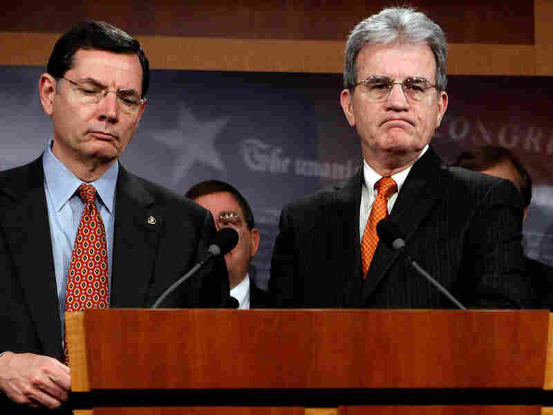 Sen. Tom Coburn of Oklahoma (right), seen with fellow Republican Sen. John Barrasso of Wyoming